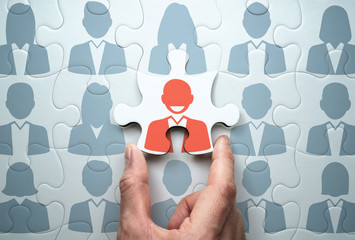 Selecting leader and building team. Business leadership concept.Connecting last jigsaw puzzle piece.