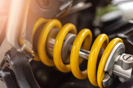 Closeup of springs, yellow shock absorbers motorcycle big bike, selective focus.