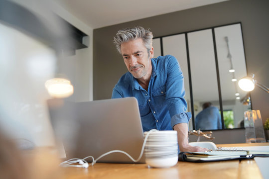 Mature man working from contemporary home