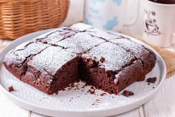 Homemade chocolate cake with icing sugar