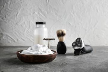 Keuken foto achterwand Boeddha Set of male shaving accessories with foam on table