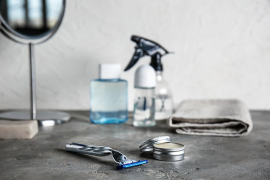 Set of male shaving accessories on grey table