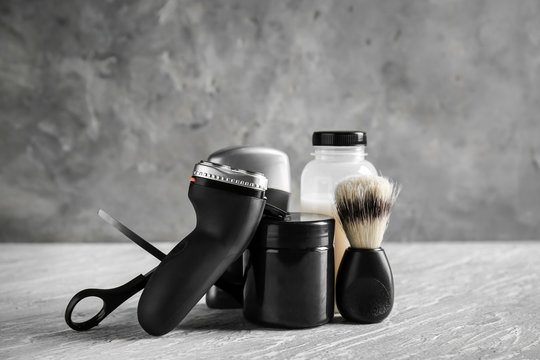 Set of male shaving accessories on table