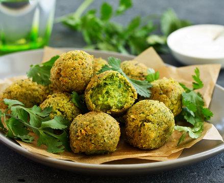 Fresh falafel balls on a dark background.