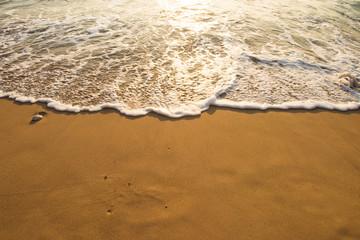 Soft wave of blue ocean on sandy beach. Background. Fototapete