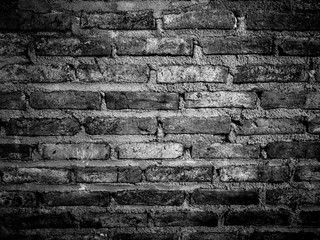 Close up grudge brick wall in black and white color