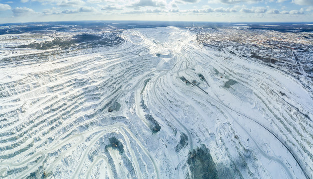 Asbest, Russia - May, 2018: Aerial panoramic shot of asbestos mining quarry at winter