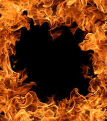 A fire frame of burning flame on dark background for abstract graphic design purpose