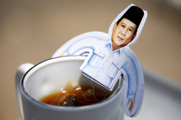 Picture of Indonesia's presidential candidate Prabowo Subianto, who was a former general of the Indonesian military, is seen on a cup during a campaign rally in Solo