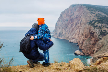 Father and son spending time together with beautiful  mountain and sea. happy family concept
