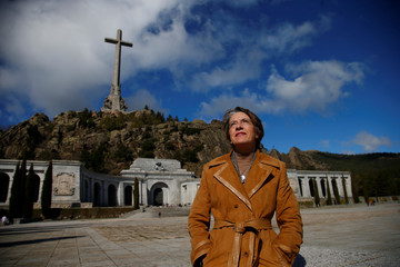 Gutierrez, a supporter of former dictator Francisco Franco, poses for a picture outside the Valle de los Caidos in Spain