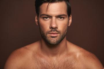 Obraz Close up confident young muscular male model - fototapety do salonu