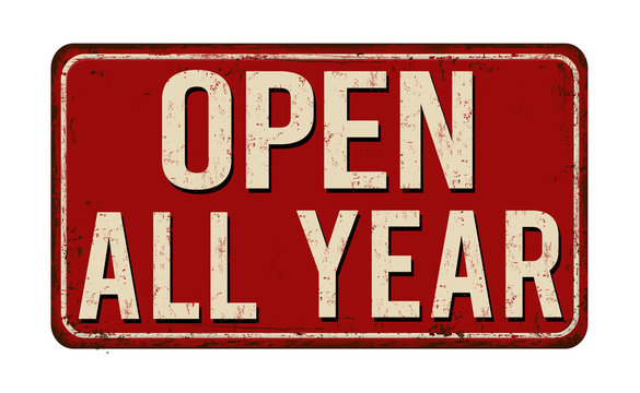 Open all year vintage rusty metal sign