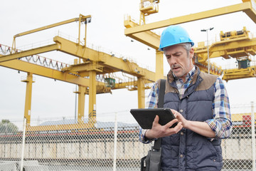 Mature construction worker inspecting work sight