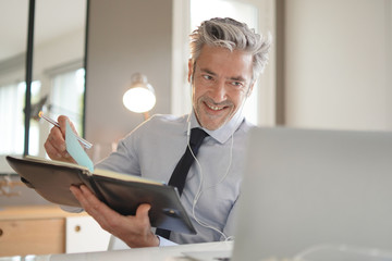 Businessman on video call in contemporary office