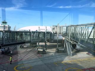 Two jet bridges leading into a double-decker plane