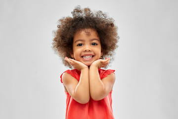 childhood and people concept - happy little african american girl over grey background