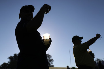 Golf patrons use cameras to take pictures during the final day of practice for the 2019 Masters golf tournament at the Augusta National Golf Club in Augusta, Georgia, U.S.