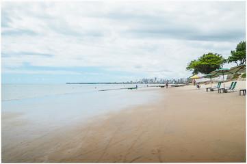 Bessa beach (praia do Bessa) at Joao Pessoa, Paraiba - Brazil. People at the beach of Bessa.