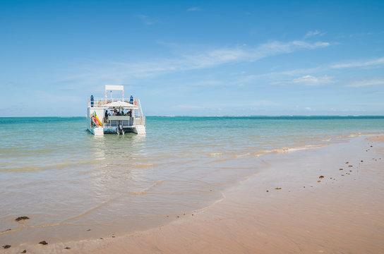 Catamaran boat that makes tours with tourists docked on the Praia do Bessa beach, Joao Pessoa PB, Brazil.