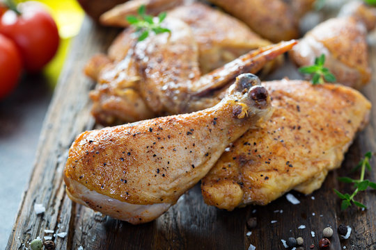 Roasted or smoked whole carved chicken on a cutting board