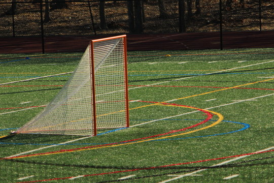 Lacrosse goal on turf field before a game.