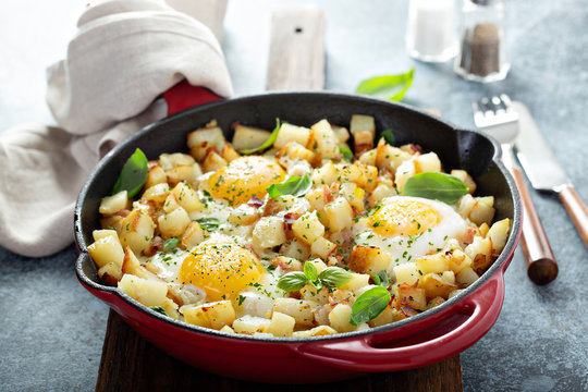 Potato hash with ham, herbs and eggs for breakfast