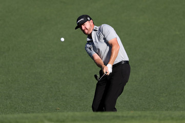 Jimmy Walker of the U.S. chips to the second green during the final day of practice for the 2019 Masters golf tournament at the Augusta National Golf Club in Augusta, Georgia, U.S.