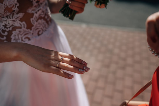 bride's hand with a ring in the beam of light