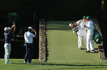 Matsuyama and Kodaira take pictures of their caddies during the final day of practice for the 2019 Masters golf tournament at the Augusta National Golf Club in Augusta, Georgia, U.S.