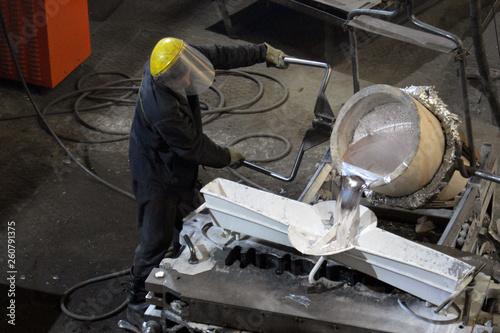Pouring molten aluminum into the mold