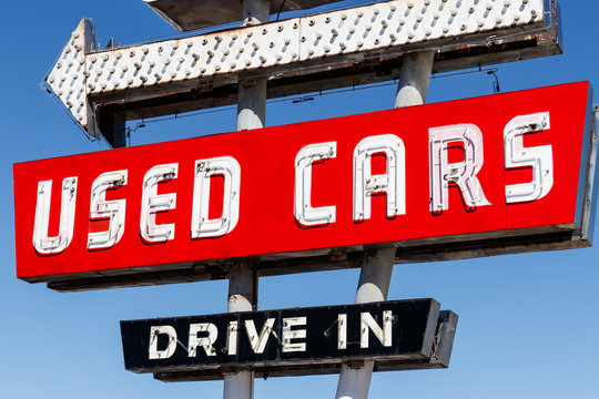 Used Car Drive In neon sign from the 50s at a pre owned car dealership I