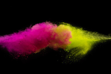 Fototapete - Collision of two colored powders isolated on black