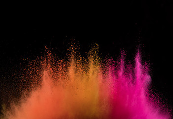 Fototapete - Explosion of colored powder isolated on black