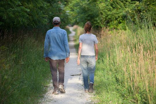 People Man Woman Unidentified Couple Walking Away Nature Trail Back Side