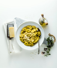 plate of italian cooked ravioli tortellini with parmesan cheese on the table. healthy Mediterranean food