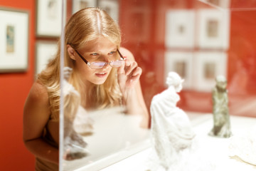 Woman with glasses visiting historical museum