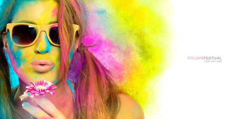 Beautiful young woman covered in rainbow colored powder. Colors festival. Beauty spring concept