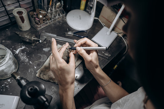 The master jeweler applies markup to the jewelry
