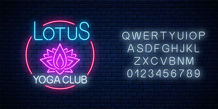 Neon glowing sign of lotus yoga club in circle frame with alphabet. Street lights signboard of chinese gymnastics.