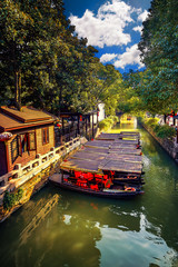China traditional tourist boats on canals of Suzhou Water Town in China