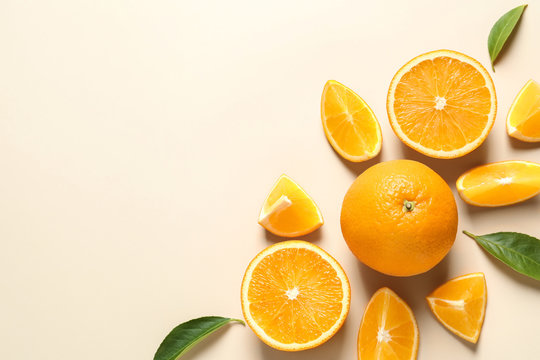 Flat lay composition with ripe oranges and space for text on color background