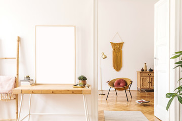 Sunny scanidnavian interiors of apartment with mock up poster frame, wooden ladder, gold armchair, design accessories and furnitures, plants and yellow macrame. Stylish home decor of rooms. Real photo