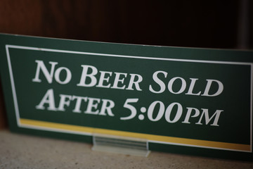A beer sign is shown at a concession stand during practice for the 2019 Masters golf tournament at the Augusta National Golf Club in Augusta, Georgia, U.S.