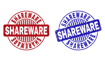 Grunge SHAREWARE round stamp seals isolated on a white background. Round seals with distress texture in red and blue colors. Vector rubber imprint of SHAREWARE text inside circle form with stripes.