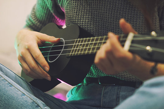 Young girl playing guitar music solo instrumental