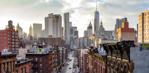 New York City - Panoramic view of the crowded buildings of the Manhattan skyline at sunset.