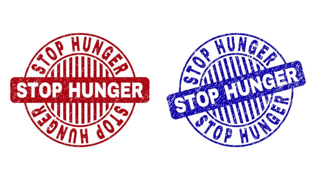 Grunge STOP HUNGER round stamp seals isolated on a white background. Round seals with distress texture in red and blue colors.