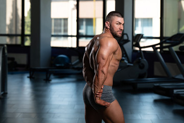 Bodybuilder Performing Side Triceps Pose