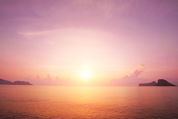 Sunrise horizon cool sea background on horizon tropical sandy beach; relaxing outdoors vacation